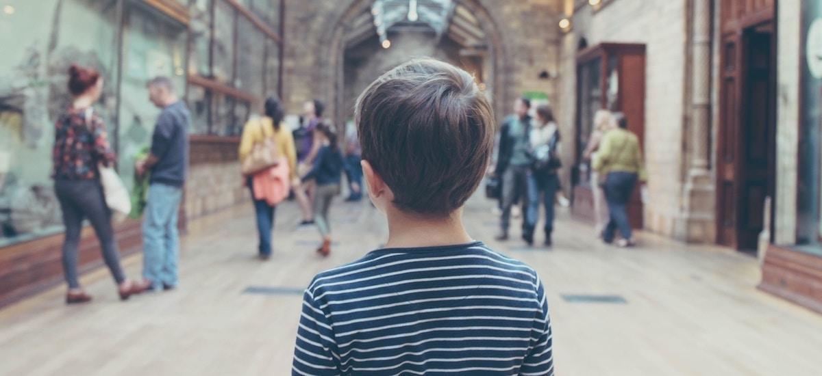 Boy lost in art gallery.